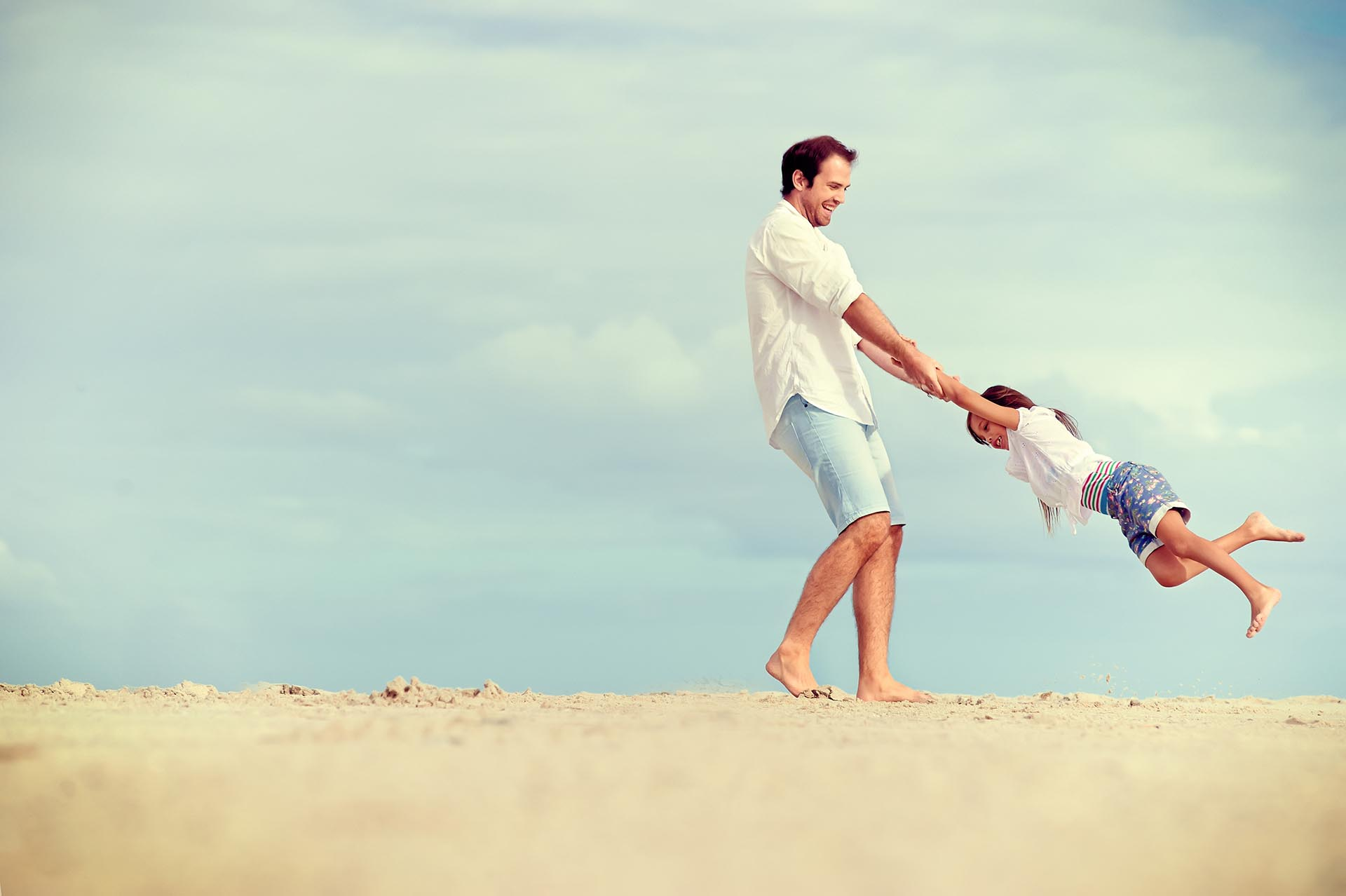 Dad-and-Child-on-Beach